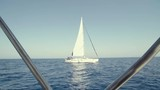 A Boat sailing in the sea in Cyclades islands in Greece, for vacation and trip, shot from another boat - 224347142
