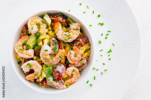 Fototapeta mayo based salad with steamed prawns, cherry tomatoes, corn, and avocado decorated with green onion