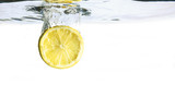 lemon slice is falling into the water, isolated on a white background, copy space - 224377934