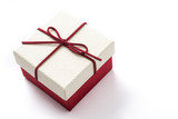 White and red gift box isolated on white background. Copyspace