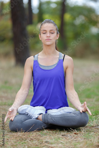 woman doing a lotus yoga posture