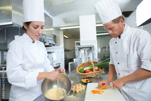 male and female chef working at kitchen
