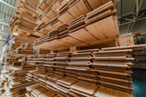 racks with a parquet board are in the warehouse of factory. Manufacturing of a parquet board. - 224429151