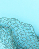 Fishing net with space for your text. Blue background for a fishery theme. - 224429997