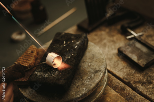 Jeweler solders a metal ring © Jacob Lund