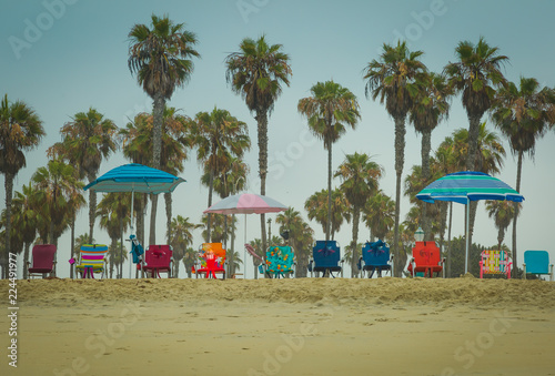 Beach Chairs That Sit Low To The Ground Are Lines Up On And Ready For Vacationers Upon Them Enjoy Their Beautiful Day By Sea