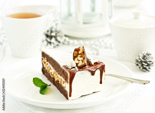 Sticker Chocolate Cake with caramel and nuts.