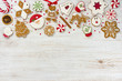 Leinwanddruck Bild - Christmas gingerbread and sweets on wooden background with copy space