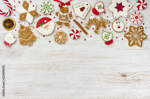 Leinwanddruck Bild Christmas gingerbread and sweets on wooden background with copy space