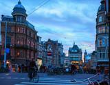 Amsterdam's city life near the Singel canal (view from Koningsplein bridge)  in the dusk, Netherlands. - 224500718