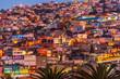 Leinwanddruck Bild - Colorful houses illuminated at night on a hill of Valparaiso, Chile