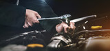 Auto mechanic working on car engine in mechanics garage. Repair service. authentic close-up shot - 224513125
