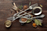 Various herbs and spices on wooden table. - 224528348