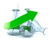 Chemistry flasks with green arrow