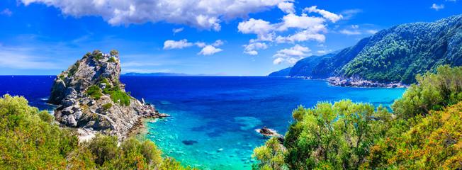 Beautiful Greek islands- Skopelos. view of rock and church Agios Ioanis. northen Sporades