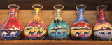 Sand bottle souvenirs at the Madinat Jumeirah Souk, Dubai, UAE. Handmade, full.  Decorative glass bottles with colored sand inside making shapes of desert and camels - 224535774