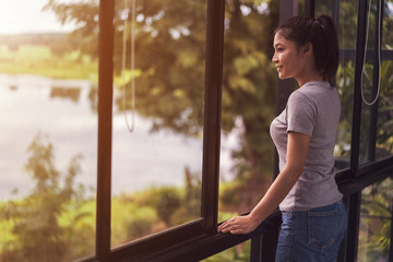 woman open window and looking to nature