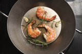 roasted king prawns with rosemary and garlic in a pan, food and cokking concept, high angle view from above with copy space - 224566500