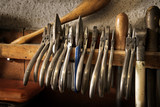 different goldsmiths pliers and tools on the jewelry workplace - 224566718