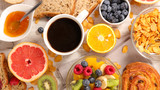 coffee cup with fruit and bread