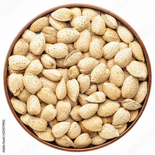 almond nuts in a round tray - 224579962