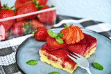 Classic traditional German Strawberry Cake on blue dish with mint leaf and fresh strawberry. - 224596770