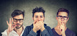 Leinwandbild Motiv Three secretive men keeping mouth shut.