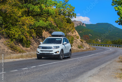 SUV on road in mountain district - 224608568