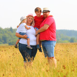 Overweight family together outdoor.  Parents with her kids enjoying life during summer vacations. - 224614301