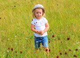 A country girl playing on summer meadows. Happy life on Czech countryside. People and sustainable development in European Union.  - 224614320
