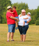 Overweight family together outdoor.  Parents with her kids enjoying life during summer vacations. - 224614355