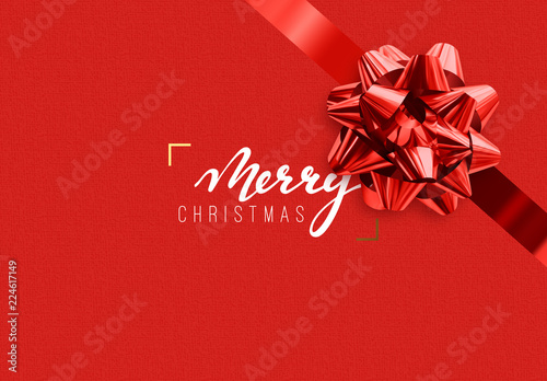 Merry Christmas Holiday background. Handwritten text, realistic textured pattern, pull ribbon bow.
