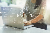 Digital marketing with woman using her laptop in her home office - 224617997