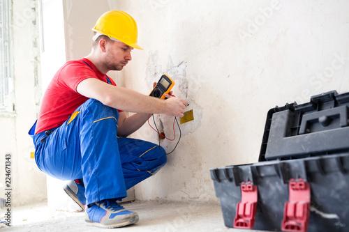 Leinwandbild Motiv Wall socket current checking with unimer