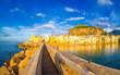 Quadro Cityscape of Cefalu at sunset. Romantic scene on the coast of Sicily island, Italy