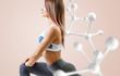 Quadro Athletic fitness woman standing near white molecule chain.