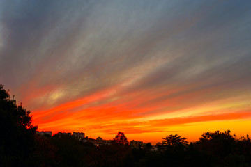 Blurred city background - sunset colors. Winter sunset in Israel.