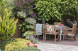 Beautiful backyard with a terrace and garden furniture. Real photo