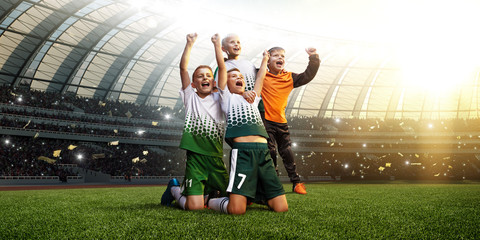 winning football player Children after score in a match