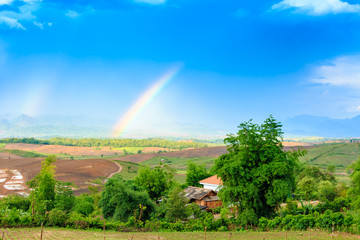 Rainbow in the mountain valley of Laos.