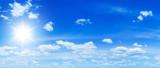 Panorama of beautiful cloudy sky and sun shining. Nature background.