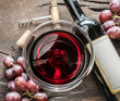 Quadro Wine glass, wine bottle and grapes on wooden background. Wine tasting.