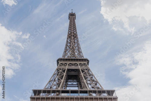 close up of Eiffel tower against cloudy sky