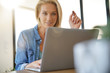 Leinwandbild Motiv Blond woman at home shopping online