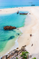 Relaxing atmosphere on the white sand beach and beautiful sea.