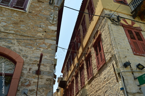 Beautiful Brick Buildings Light Brown With Nice Red Windows In Nauplion. Architecture, Travel, Landscapes, Cruises. July 8, 2018. Nauplion Argolida Greece.