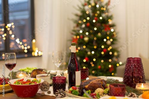christmas dinner and eating concept - food and drinks on table at home - 224743597