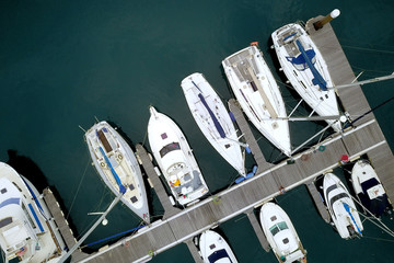 Yacht parking, A marina lot, Yacht and sailboat is moored at the quay, Aerial view by drone.