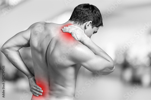 Leinwanddruck Bild Strong man with neck pain, back view