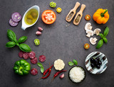 The ingredients for homemade pizza on dark stone background. - 224801132